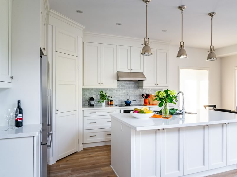 The all-white kitchen with quartz counters is timeless, fresh and clean.