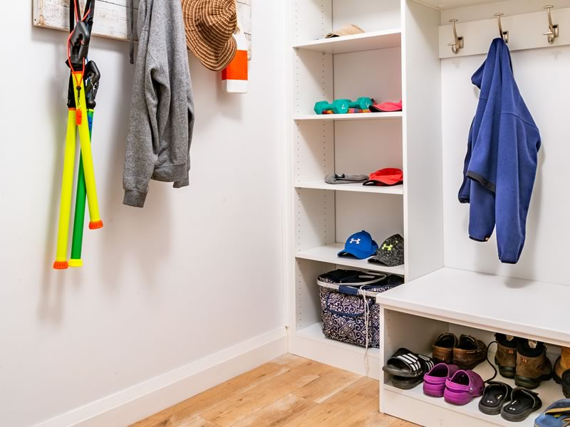 The mudroom and laundry room are located off the hallway just inside the front door.